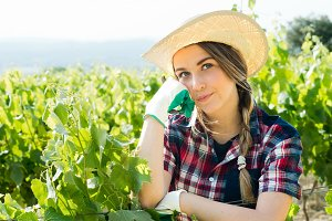girl farmer in the vines thinking