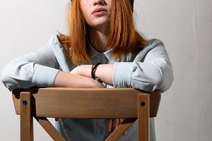 Girl sits on a chair