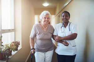 Nurse assisting a senior patient