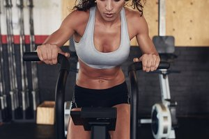 Fitness woman on bicycle