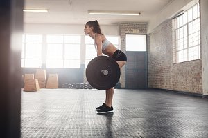 Fitness woman doing weight lifting