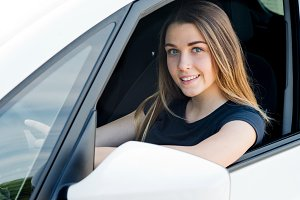 beautiful young woman in the car