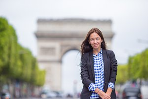 Young woman on the Champs Elysees in Paris