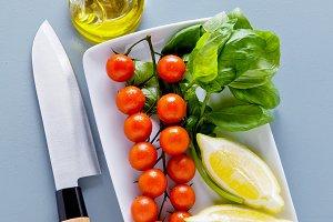 basil, cherry tomatoes, lemon.