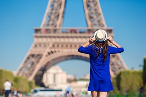Beautiful woman background the Eiffel tower in Paris, France