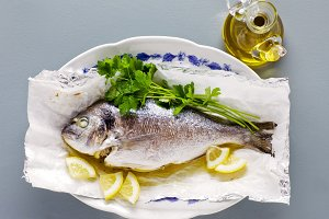 cooked fish , lemon