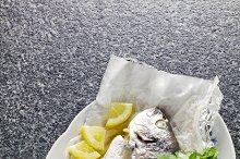 cooked fish , lemon