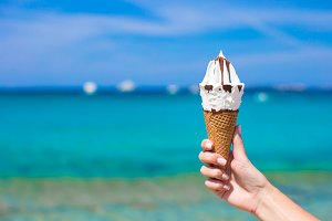 Closeup of tasty ice cream background the turquoise sea