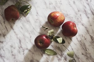 Juicy apples, on marble table