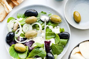 Salad plate, pita bread and olives