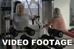 Senior women training on exercisers