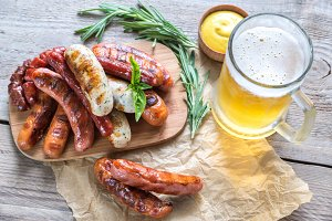 Grilled sausages with glass of beer