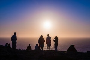 People in the sunset at Cape St. Vincent, Portugal