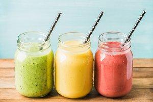 Three jars of fresh fruit smoothies