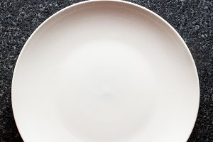 Empty Plate on black Marble