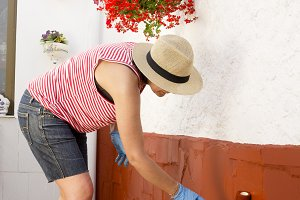 woman painting the backyard