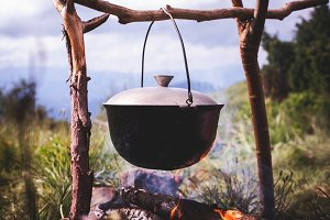 Cauldron on fire in forest