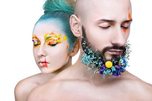 Portrait of a woman and man with creative colorful makeup