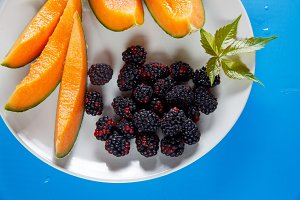 cut Cantaloupe and Blackberries