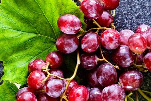 Ripe red Grape with leaves