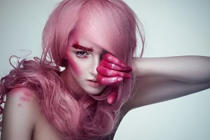 Girl with creative pink make up