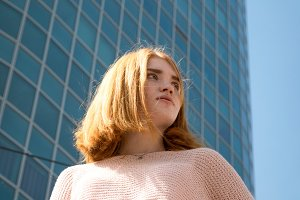 Girl stands of a skyscraper