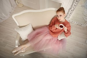 Ballerina drinking black tea