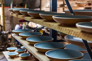 Plates sorted in a ceramist workshop