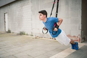Man training with TRX straps