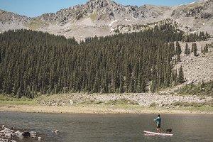Man and Dog on Paddle Boat