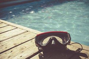 Snorkeling mask on swimming pool
