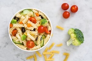 Pasta salad on marble background