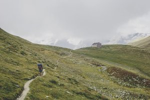 Hiker walking to a mountain hut