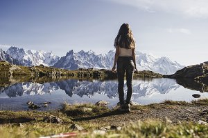 Girl on a lake in the Alps