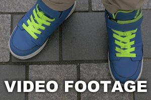 Kid feet in blue trainers