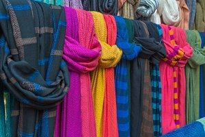 scarves in a textiles market.