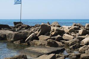 Greek flag on the beach