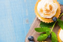 Mini lime curd tartlets with meringue.