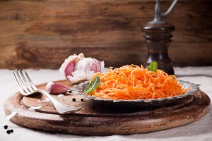 Spicy Korean style carrot salad on metal plate