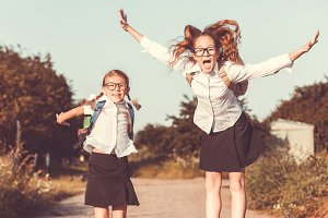 Two happy schoolgirls.