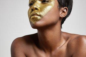 glitter heart on black model's face