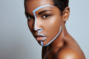 black model in a makeup process