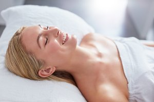 Smiling woman in a day spa