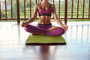 Female meditating in yoga class