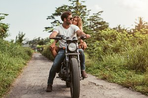 Couple on motorbike driving