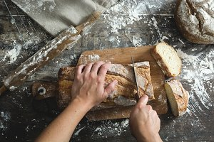 Woman cutting bread