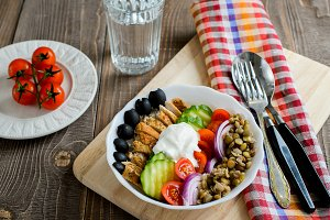 Chicken lentil and tomatoes salad with olives