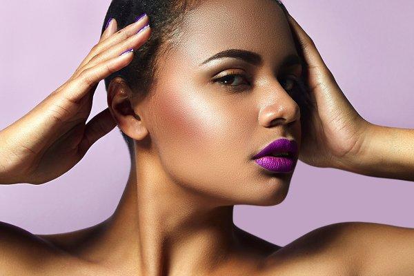 Mulatto with purple lipstick.