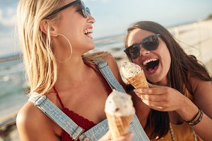 Two best friends having ice cream