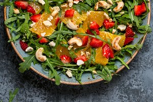 salad with arugula, fruits and nuts